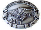 Farming belt buckle with harvester and cobs of corn on border