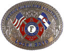 Oval Firefighter belt buckle with Maltese cross and American flag with engraved background and rope border