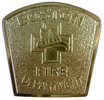 Fire Department belt buckle with fireman helmet and polished stippled background