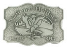 Eagle capturing fish and trees enclosed in oval on this belt buckle with stippled background