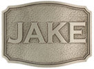 Rectangular belt buckel with stippled background and personal name