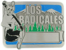 Snowboarding belt buckle with mountains and trees in background